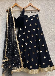 Stylish Black Velvet blouse with gathered net teamed with a Black and Gold skirt with Sequins flowers and a shimmering gold border. Accompanied by a lovely scallop dupatta with gold buttis liberally scattered. Black Lehenga, Indian Lehenga, Lehenga Choli, Gold Lehenga, Peach Lehnga, Yellow Lehanga, Saree, Net Lehenga, Pakistani