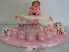 Pink and white little girl's doll cake