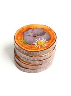 Flatten your mom's favorite blooms and preserve them on wood slices with resin to make these meadow-like coffee table accents. Get the tutorial at The Crafted Life »