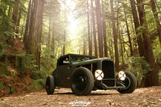 A timeless photo of the 27' Hotrod in the woods.