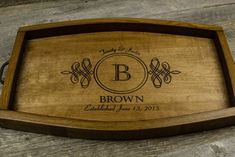 Personalized Wine Barrel Serving Tray. This beautiful tray is made from the staves of a retired wine barrel and makes a gorgeous addition to your home décor. The inside of the staves are stained by the wine that rested in the barrel during the production process. We put a light coating of the stain of walnut stain. To complete the tray we finish it with a polyurethane clear coat for protection. This will make a GREAT gift for Christmas, weddings, engagements, anniversaries, or JUST…
