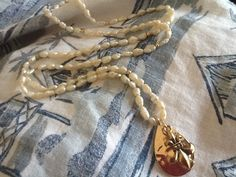 Fleur de Lis/ long pearl necklace/ women's necklace/ by Ivanwerks