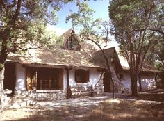 Cob home (900 square ft) in Austin Texas. Built and owned by Gary Zuker. The total cost (in 2000) including appliances, septic and well was about $40,000. Costs for structure: 250 bales of straw ($375), 6 cubic yards of blue clay ($25), 60 tons of limestone boulders ($120), and 50 planed pine timbers ($2000). motherearthliving.com