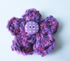 Purple Knitted Brooch with Polka Dot Button by thesequinnedsheep