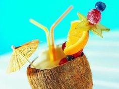 Tropical & Colorful Drinks admired by our rattan...   Wicker Blog