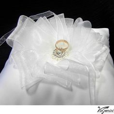 Wedding ring bearer pillow - White satin with organza ribbon flower and rhinestone center.