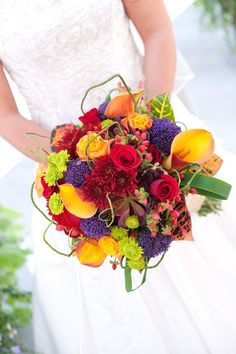 Once you get past the color of this gorgeous bouquet, check out the article it comes from: The 3 Most Expensive Parts of a Wedding and How to Cut Costs (hint - one of them has to do with flowers, the others with the venue and the dress).