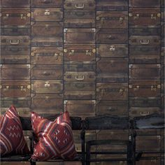 Industrial Wallpaper - A richly textured wallpaper design featuring stacks of old fashioned suitcases. Produced in Britain by Andrew Martin Home.