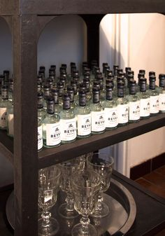 Playful display of stock of vodka on industrial pedestal by Atelier 154.