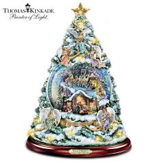 "Thomas Kinkade Silent Night Nativity Tabletop Christmas Tree With Swirling Snow - features 15 nativity figures and a banner that reads, ""Unto Us a Child Is Born"" Tabletop Christmas Tree, Christmas Tree Decorations, Gifts For Older Women, Thomas Kinkade Christmas, Silent Night, Favorite Holiday, Snow Globes, Water Globes, Decorative Bells"