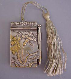 Notepad chatelaine pendant.