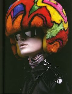 http://www.fashionschooldaily.com. want this. or a helmet with a blonde fro on it.