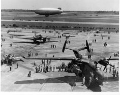 Naval Air Station Oceana air show in the mid-1950s. Immediately below the U.S Navy blimp are the Grumman F9F Panther Blue Angels.