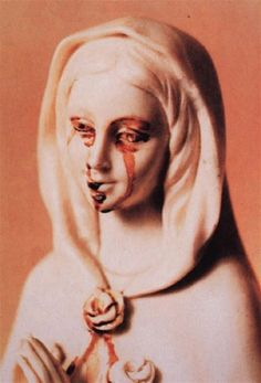 malformalady: Statue of the Virgin Mary supposedly weeping blood
