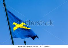 New stock photo available at Shutterstock: Flag in the wind on blue sky background. by eZeePics Studio, via ShutterStock