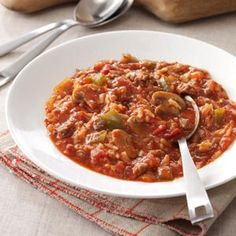 Unstuffed Pepper Soup Recipe -One of my sisters gave me the recipe for this quick-and-easy soup that tastes just like stuffed green peppers. The thick hearty mixture is chock-full of good stuff. Plus, the aroma while it's cooking is wonderful. —Evelyn Kara, Brownsville, Pennsylvania