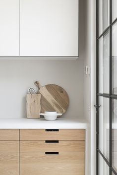 modern kitchen, wood and white, black steel-framed door