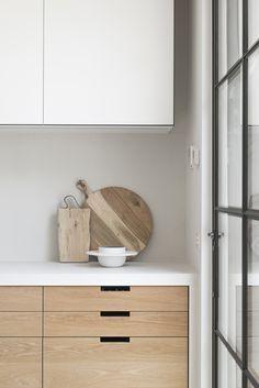 modern kitchen, wood and white, black steel-framed door