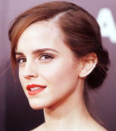 Emma Watson wears a bold and edgy Ana Khouri ear cuff.
