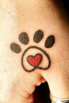 Paw & heart (in memory of passed pets) - located on my right hand in the soft spot between my thumb & index finger