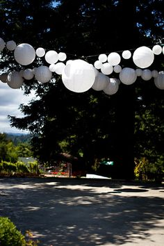 Hang different sized white paper Chinese lanterns in a 'X' shape to make a pretty feature over the dance floor.