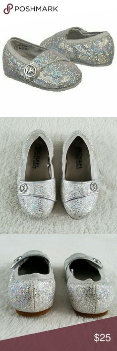"""MK """"Lil Grace"""" baby girl shoes ABSOLUTELY ADORABLE Michael Kors baby girl shoes. These """"Lil Grace"""" sparkly iridescent shoes are in great shape, gently worn. Velcro strap for easy slip on with a silver MK logo. Elastic around the top of the shoe keeps it on for girls on the go! Michael Kors Shoes"""