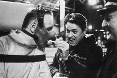 Director Jonathan Demme feeding Hannibal Lecter a french fry on the set of Silence of the Lambs