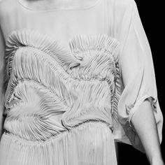 Decorative Pleat Patterns - thin pleats; fabric manipulation; dress closeup; fashion details
