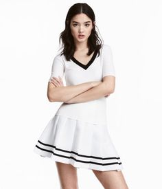 White. Fitted, short-sleeved sweater in a soft rib knit with a low-cut V-neck. $17.99