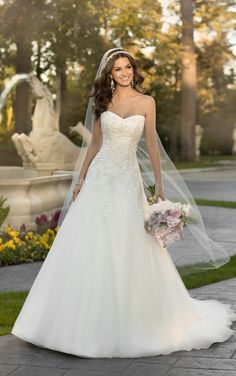 5959 Lace and Organza A-Line Wedding Dress by Stella York I like where it flares, wish the texture was scattered throughout skirt