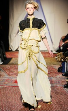 Here is another airy dress that would represent Miranda's costume. I like the color scheme with the black on top and the white on the bottom. The gold textured lines throughout the dress show color, contrast and direction.