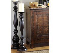 How to make $12 floor candlesticks... Buy newel posts (for the end of stairs) or bedposts from Home Depot, cut to size, place in fence post toppers (ones with a flat top) - making sure they are level, and then spray paint them! Voila!!!
