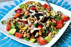 Arugula, shredded chicken, strawberries, tomatoes, dried cherries, walnuts, avocado, olive oil and balsamic.