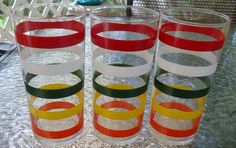 THREE VINTAGE RETRO STRIPED DRINKING  GLASSES; very primary colorful larges stripes  which add immensely to the pleasure of drinking from these Anchor Hocking glasses.