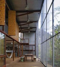 Mosquito-Net Facade-A giant mosquito net forms the entire facade on both sides of this house for Sao Paolo, in Brazil, a short stroll from the sea.  The RR Casa is entirely open to cross breezes straight through the house – sheltered under a huge, simple outer shell structure.