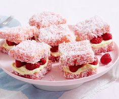 These raspberry and cream cheese layered delights are a fun twist on the classic Australian lamington and are filled with fresh raspberries for a cute treat.
