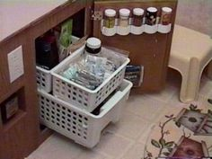 RV storage white baskets stacked for low and hard to reach cabinets