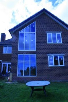 A 2 Storey extension as part of a complete renovation project of a house in Ashbourne, Derbyshire. The large triangular first floor window is at the top of a reconfigured staircase. Derbyshire, New Builds, Extensions, Channel, Windows, Flooring, Building, Board, Outdoor Decor