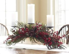 "Melrose Winterberry Candle Holder Size: 35"" x 12"" x 9.5"" Material: Metal, Plastic, Foam Color: Red, Green This swirling metal candle holder is accented by a lush mix of winter berries and pine. **Candles not included**      **This item ships directly from our supplier's warehouse. Ships only to the lower 48 states. Cannot be shipped to a PO box."