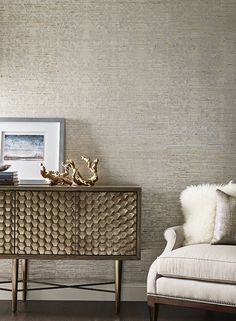 Come to your local Benjamin Moore to achieve this subtle feathered stripey look with gold foil accents. Botanical Organic by Candace Olson for York Wall Coverings!