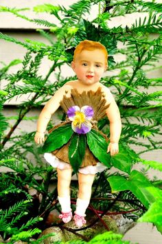 Pansy Fairy made with victorian articulated paper doll and victorian paper flower components.