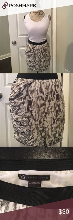 """Armani Exchange Skirt Beautiful black and white by Armani Exchange. Size 4 and measures about 15"""" from the top of waistband to bottom of skirt.  Black elastic waist band for comfort and a side zip with clasp for closure. Armani Exchange Skirts"""
