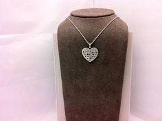 A nice Sterling necklace and decorated heart pendant.
