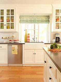 Kitchen ideas, we have creamy white cabinets and want to do black sparkly counter tops. Plus I'm rethinking tiling the kitchen floor and instead do laminate wood flooring.