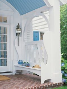 Good porch ideas. The seat, the color, the opening above the bench.