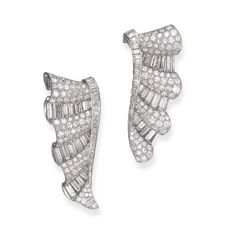 A PAIR OF STYLISH ART DECO DIAMOND BROOCHES   Each designed as an undulating ribbon of alternating pavé-set and baguette-cut diamonds, with a baguette-cut diamond trim, mounted in platinum, circa 1930, with French assay marks