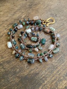 Long Bohemian styled crocheted necklace featuring both barrel and rondelle shaped moss agate gemstones create this easy to wear organic