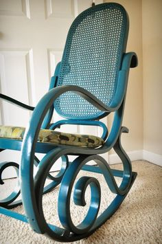 Cane Rocking Chair Makeover-actually had a rocking chair like this when I had my apt. Never liked the wicker back. :/ But the scroll design on the legs is beautiful!: