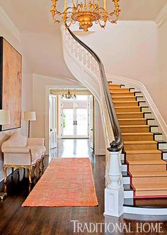 A sparely furnished entry leaves room for the grand old house to breathe, and continue to grow with its young family. - Photo: John Granen / Design: Mark Ashby and Mary Ames