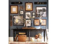 Entry Way Wall Decor... A collage of pictures and initials, house number/established date; also has large items on entry table to help fill the large space